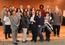 """City Councillors and Malden Reads representative pose with the 2017 choice, """"A Man Called Ove"""" by Fredrik Backman."""